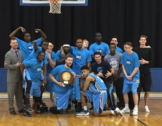 The Storm men's basketball team poses with its regional championship plaque.
