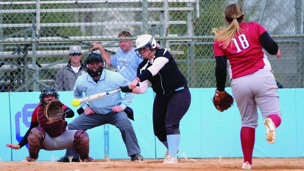 Brooke Simonton, a second year first baseman from Minden, swings during a double-header loss to Hesston College in March.