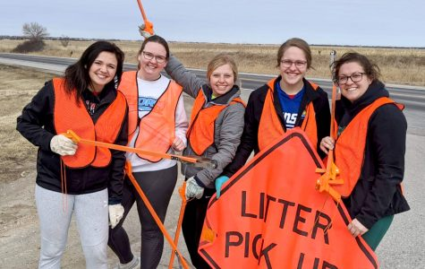 Participating in litter pickup were, from left, posing with the Litter Pick Up Sign: Hailey Schafer (Tobias), Addison Schramm (Fairbury), Breanna Miller (Daykin), Erin Rombeck (Beattie, Kan.), and Lindsay Homolka (Diller).